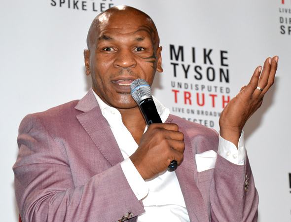 Boxer Mike Tyson took on Broadway in his solo tell-all, <i>Undisputed Truth</i>, at the Longacre Theatre. Spike Lee directed the show, which opened on August 2.<br />(© David Gordon)