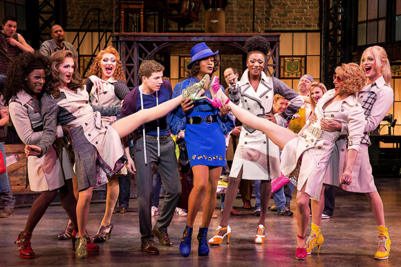 Stark Sands and Billy Porter (center) lead the cast of the new Cyndi Lauper-Harvey Fierstein musical, <i>Kinky Boots</i>, which Jerry Mitchell directs at the Al Hirschfeld Theatre. The production opened on April 4.<br />(© Matthew Murphy)
