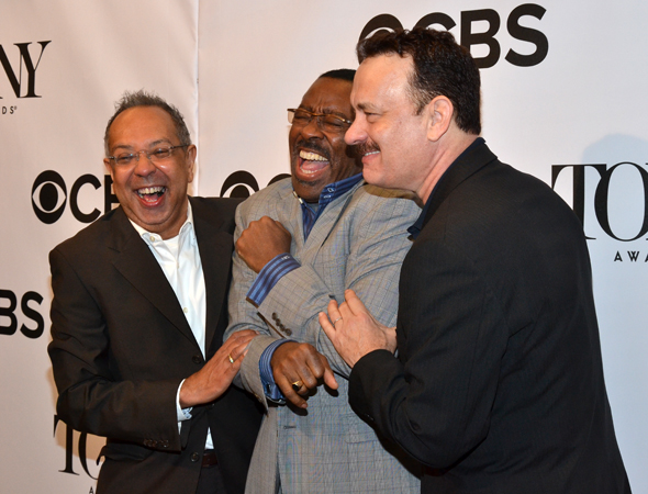 <i>Lucky Guy</i>'s George C. Wolfe, Courtney B. Vance, and Tom Hanks share a laugh on the red carpet.<br />(© David Gordon)