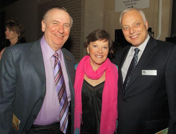 Helen Carey (center) smiles alongside board members  Larry Franks and Mark Shugoll. <br />(© Jon Harvey)