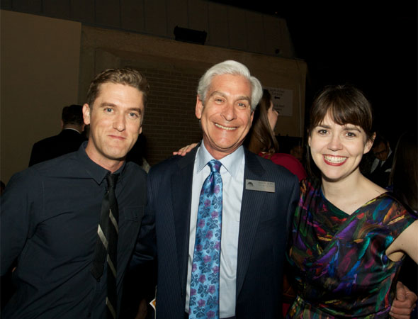 Scott Drummond and Emily Donahoe snap a picture with Arena Stage board chair David Shiffrin (center).<br />(© Jon Harvey)