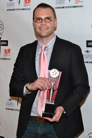 Playwright Samuel D. Hunter shows off his award for <i>The Whale</i>, which was named Outstanding Play.<br />(© David Gordon)