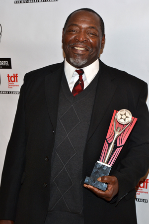 Chuck Cooper proudly shows off his Outstanding Featured Actor award for his performance in August Wilson's <i>The Piano Lesson</i>.<br />(© David Gordon)