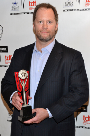 Shuler Hensley proudly receives a Lortel Award for his performance as a six-hundred-pound dying man in <i>The Whale</i>.<br />(© David Gordon)