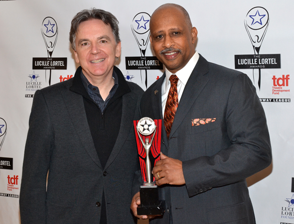 Signature Theatre Company Artistic Director James Houghton smiles alongside <i>Piano Lesson</i> director Ruben Santiago-Hudson and their award for Outstanding Revival.<br />(© David Gordon)