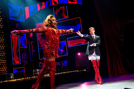 Billy Porter takes a bow on the opening night of <I>Kinky Boots</I> as castmate Stark Sands looks on.