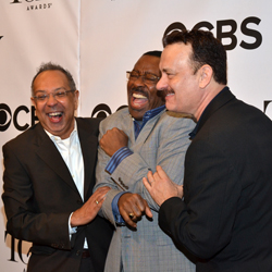 George C. Wolfe, Courtney B. Vance, and Tom Hanks share a laugh at the 2013 Tony Awards press event.