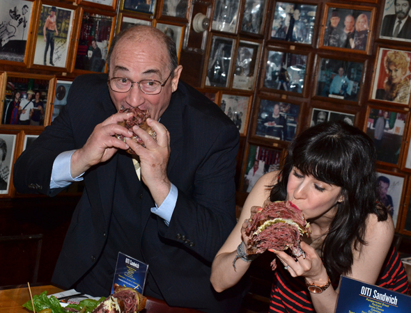 Todd Susman and Audrey Lynn Weston chow down on the massive culinary delight.<br />(© David Gordon)