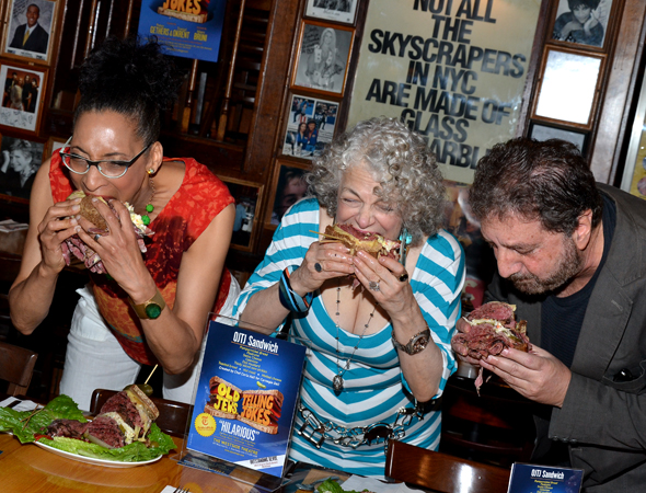 Chef Carla Hall, Marilyn Sokol, and Peter Gethers sample the sandwich.<br />(© David Gordon)