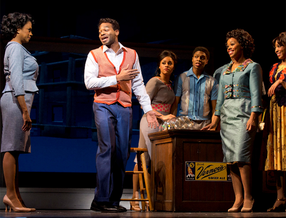 Brandon Victor Dixon (center) as Berry Gordy next to Marva Hicks (left) in the role of Esther Gordy and members of the cast of <i>Motown The Musical</i>.