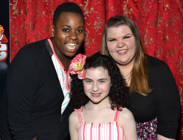<i>Glee</i> cast members Alex Newell and Ashley Fink pose alongside Lilla Crawford.<br />(© David Gordon)
