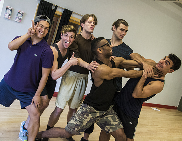 The men of the Seventh Annual Broadway Beauty Pageant in rehearsal.