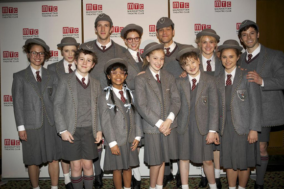 Cast members from <i>Matilda</i> smile for the camera in-costume.<br />(© Christopher Gower Johnson)