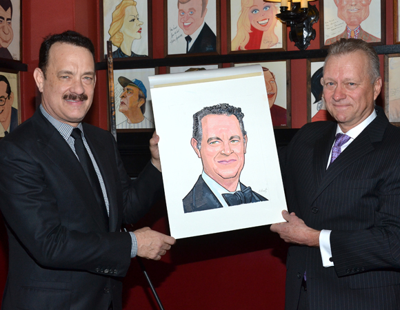 Tom Hanks and Sardi's managing partner Max Klimavicius show off the new caricature.
