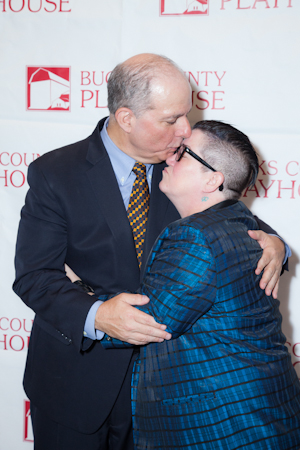 Jed Bernstein gives <i>Mame</i> cast member Lea DeLaria a kiss.<br />(© Seth Walters)