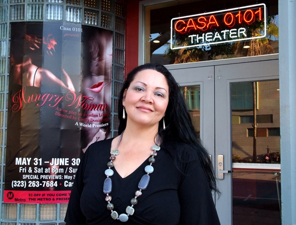 <i>Hungry Woman</i> playwright Josefina López poses in front of the Casa 0101 Theater.<br />(© Ed Krieger)
