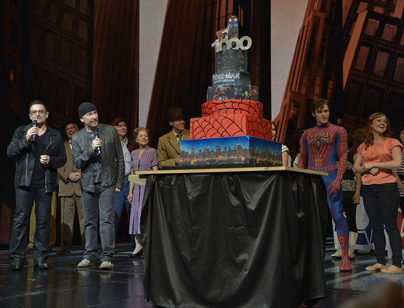 Songwriters Bono and The Edge join the cast and a multi-level anniversary cake.<br />(© Eugene Gologursky / Getty Images)