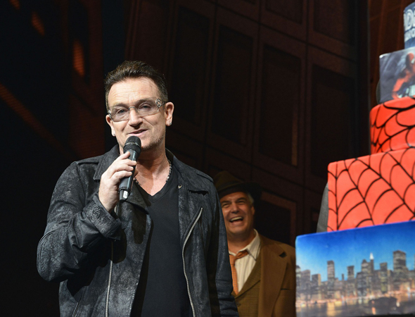 Bono shares some heartfelt words with the audience.<br />(© Eugene Gologursky / Getty Images)