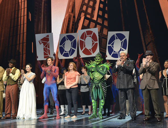 Cast members hold up numbered signs to show off their landmark 1,000th performance.<br />(© Eugene Gologursky / Getty Images)
