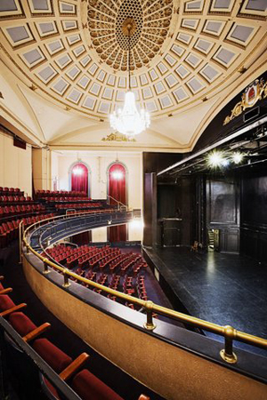 The Union Square Theater, pre-renovation, with mezzanine and orchestra levels, as well as a standard proscenium stage.<br />(© Dirk Eusterbrock)