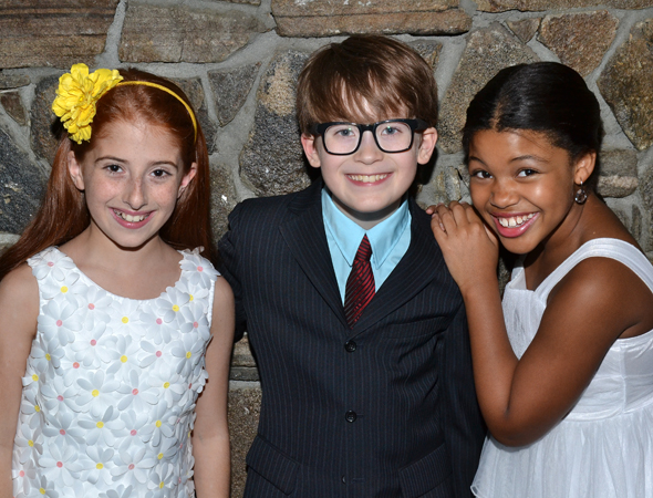 The production's children, Julianna Rigoglioso, Jake Lucas, and Elaine Bass, smile for the cameras.<br />(© David Gordon)