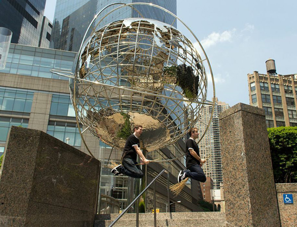 Daniel Clarkson and Jefferson Turner Pottering in front of the Columbus Circle globe.