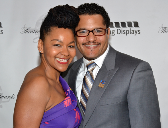 Brandon J. Dirden, a 2013 Theatre World Award honoree, snuggles up to his wife, Crystal A. Dickinson, a 2012 honoree for <i>Clybourne Park</i>.<br />(© David Gordon)