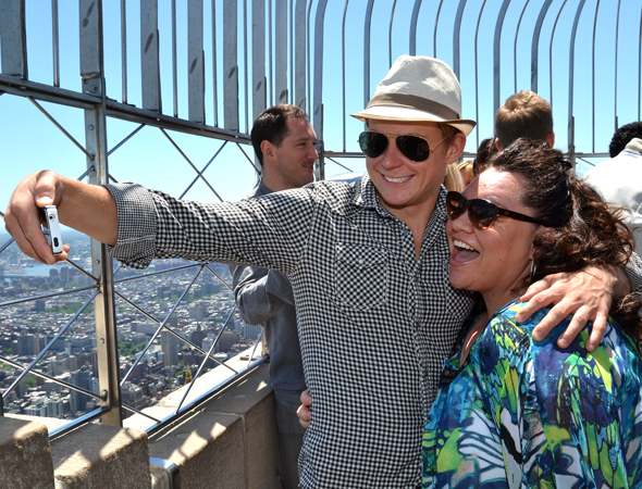 Featured Acting nominees Billy Magnussen and Keala Settle take a selfie at the top of New York City.<br />(© David Gordon)