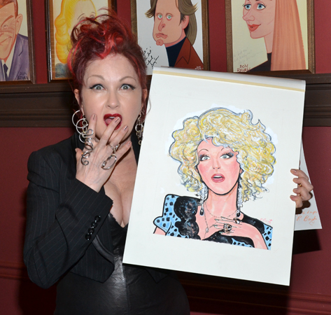 Cyndi Lauper with her brand new Sardi's caricature.