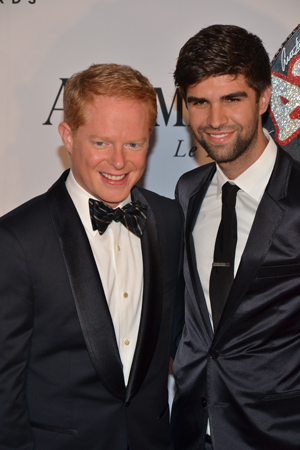 Jesse Tyler Ferguson in currently starring in the Shakespeare in the Park production of <I>The Comedy of Errors</I>. He presents tonight. Here he is with husband, Justin Mikita. <br />(© David Gordon)
