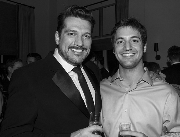 2008 Tony Award winner Paulo Szot shares a photo with Joshua Johnston.<br />(© David Gordon)