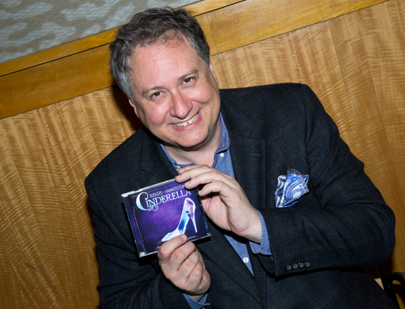 Douglas Carter Beane shows off his new favorite CD.<br />(© David Gordon)