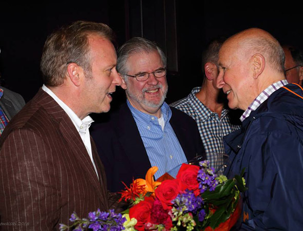 Christopher Durang (center) and his partner John Augustine (left) present Terrence McNally with flowers in honor of his world premiere.<br />(© Rich Kowalski)