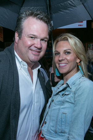 Eric Stonestreet smiles alongside his lovely date for the evening.<br />(© Simon Luethi)
