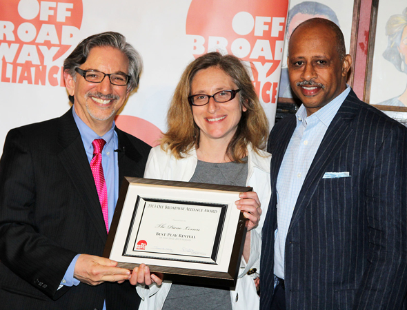 Peter Breger presents the Best Play Revival honor to Signature Theatre Company Executive Director Erika Maillin and <i>The Piano Lesson</i> director Ruben Santiago-Hudson.<br />(© 2013 Bruce Glikas/OffBroadwayAlliance)