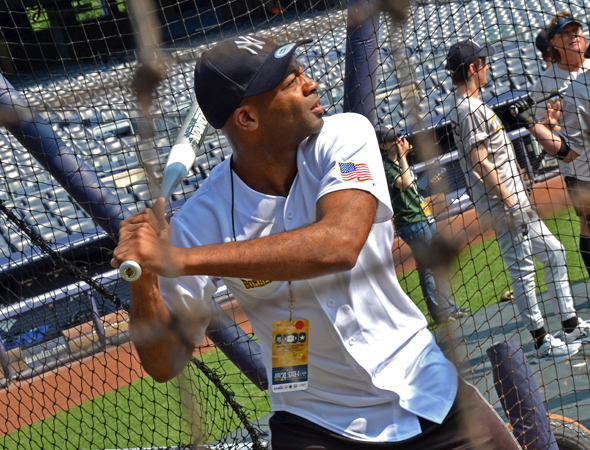 Brandon Victor Dixon takes a warm-up turn at the bat.<br />(© David Gordon)