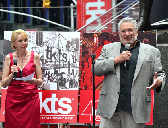 Host Julie Halston looks on as Broadway representative Harvey Fierstein shares his thoughts about TKTS.<br />(© David Gordon)