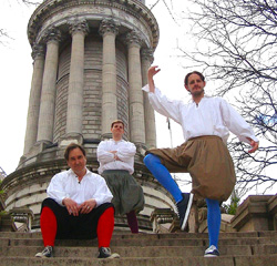 Nicholas Martin-Smith, Ian Harkins, and Chris Behan are men in tights on the Soldiers' and Sailors' Monument in Riverside Park.