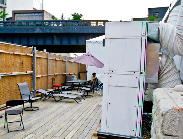 "For the actors, the place to relax and unwind is outdoors, just off Washington Street. ""Since this is only a summer show, it's viable for the green room to be a patio,"" Lien notes. ""Unless it's raining."" There are individual dressing rooms indoors, tiny as they are. ""They each have a little fourteen-inch-by-thirty-inch table,"" she says.<br />(© David Gordon)"