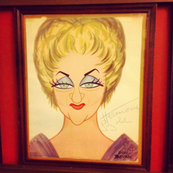 A Donald Bevan caricature of Hermione Gingold hangs on the wall at Sardi's.