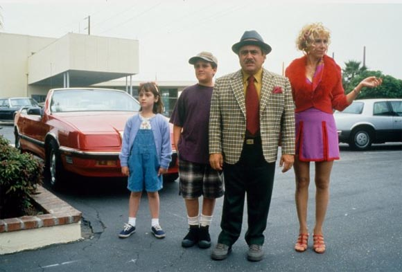 Mara Wilson, Brian Levinson, Danny DeVito, and Rhea Perlman during the filming of <i>Matilda</i>.