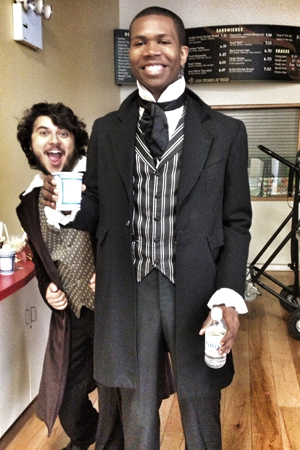 John gets into costume alongside fellow Jean Valjean, Areon Mobasher, before their group performance.
