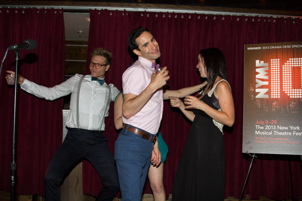 Partygoers dance it up on stage.<br />(© Seth Walters)