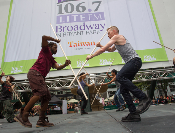 "The company of <i>STOMP</i> gets the crowd pumped with a performance of ""Hands and Feet"" and ""Brooms.""<br />(© Steve Prue)"