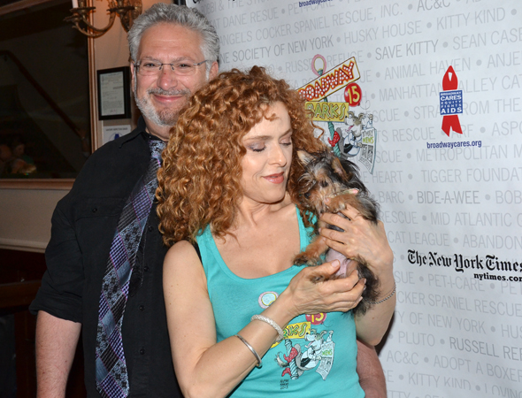 Host Bernadette Peters spends some quality time with a pup as co-host Harvey Fierstein looks on.<br />(© David Gordon)