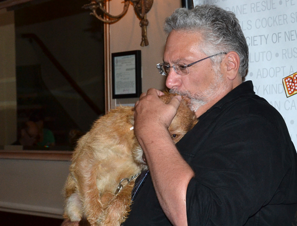 Harvey Fierstein shares a quiet moment with a four-legged pal.<br />(© David Gordon)