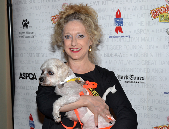 Carol Kane of <i>Wicked</i> shares a moment with a furry pet.<br />(© David Gordon)