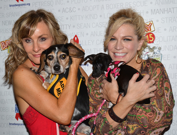 Judy McLane and Felicia Finley are unafraid to snuggle up to the doggies.<br />(© David Gordon)