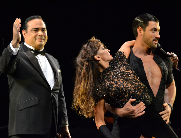 Gilberto Santa Rosa, Karina Smirnoff, and Maksim Chmerkovskiy strike a pose on stage.<br />(© David Gordon)