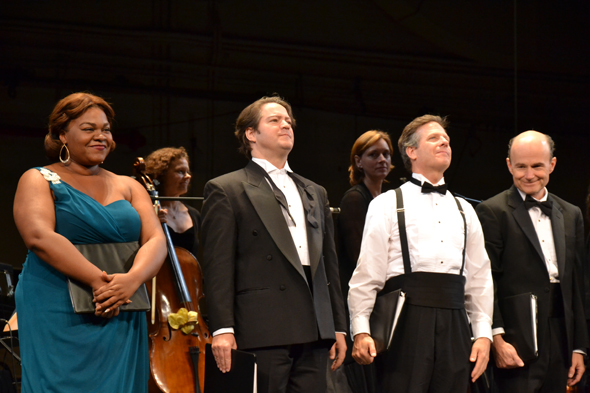 Da'Vine Joy Randolph, Robert Petkoff, Martin Moran, and Henry Stram drink in the audience's applause.<br />(© David Gordon)